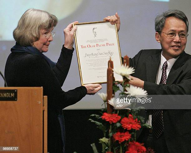 Swedish Prime Olof Palme's widow Lisbet Palme displays the Olof Palme Prize with Dr Sein Win who received it on behalf of prodemocracy activist and...
