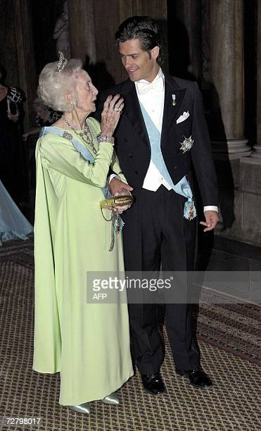 Swedish Princess Lilian and Prince Carl Philip arrive for the Nobel dinner at the Royal Palace in Stockholm 11 December 2006. AFP...