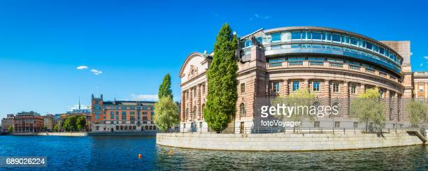 stockholm swedish parliament building riksdagshuset overlooking blue harbour waterfront sweden - politics and government stock pictures, royalty-free photos & images