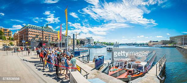 Stockholm tourists waiting for ferry on harbour waterfront panorama Sweden