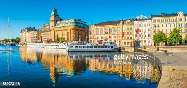 Stockholm warm early sunlight illuminating Nybroviken harbour waterfront panorama Sweden