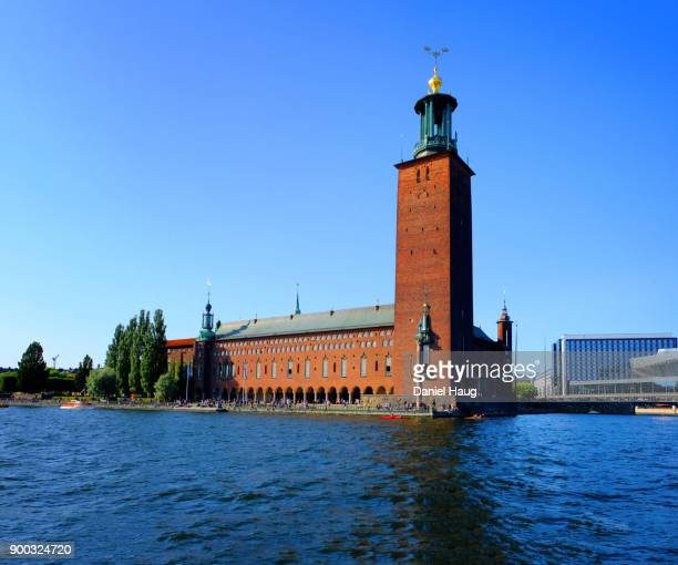 stockholm's city hall as seen from a bay on lake mälaren - venue of the annual nobel prize banquet - nobel prize stock pictures, royalty-free photos & images