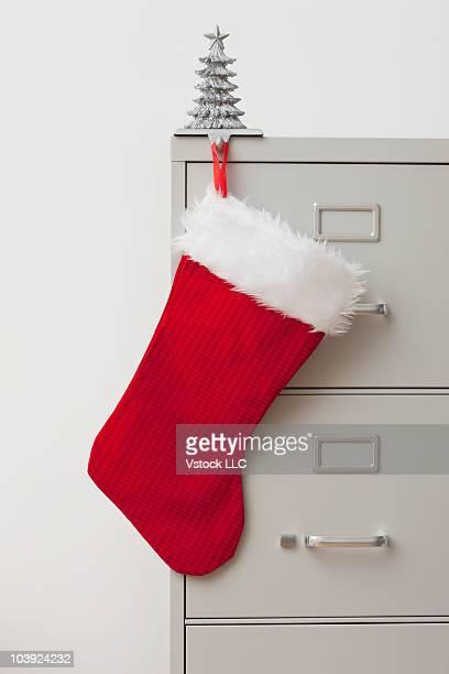 Stocking on filing cabinet
