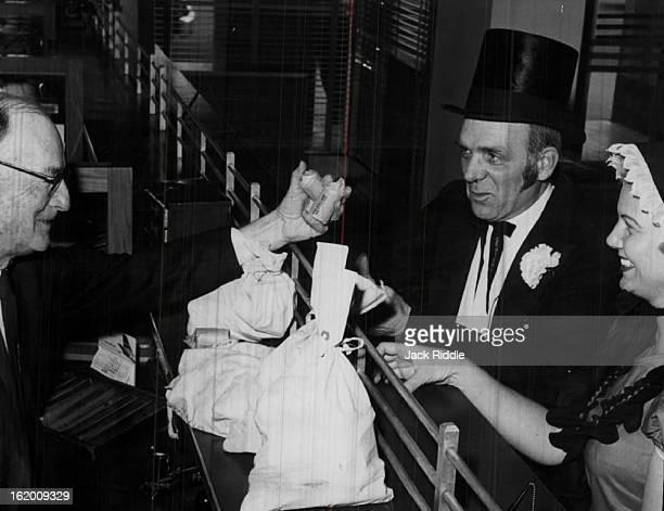JUN 2 1959 JUN 4 1959 Stocking Up for Silver Dollar Days Louis O'Brian Richard Balleweg and Mrs John J Hinterreiter