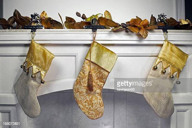 stockings on mantle - christmas stocking stock photos and pictures