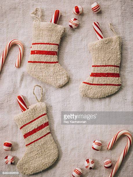 stockings with candy canes - calza della befana foto e immagini stock