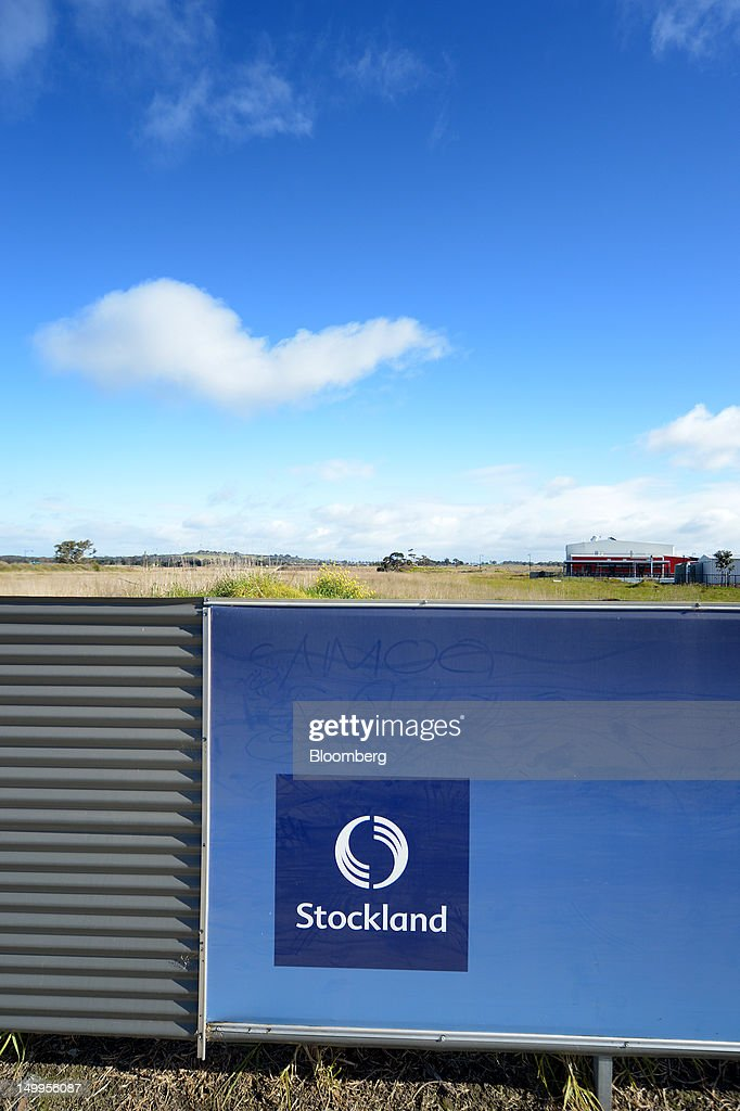 A Stockland banner covers construction fencing in a yet to be developed plot of land in the Stockland Highlands residential development in Craigieburn, an outer northern suburb of Melbourne, Australia, on Monday, Aug 6, 2012. Stockland, Australia's biggest diversified property trust, is expected to announce full-year results on Aug. 8. Photographer: Carla Gottgens/Bloomberg via Getty Images