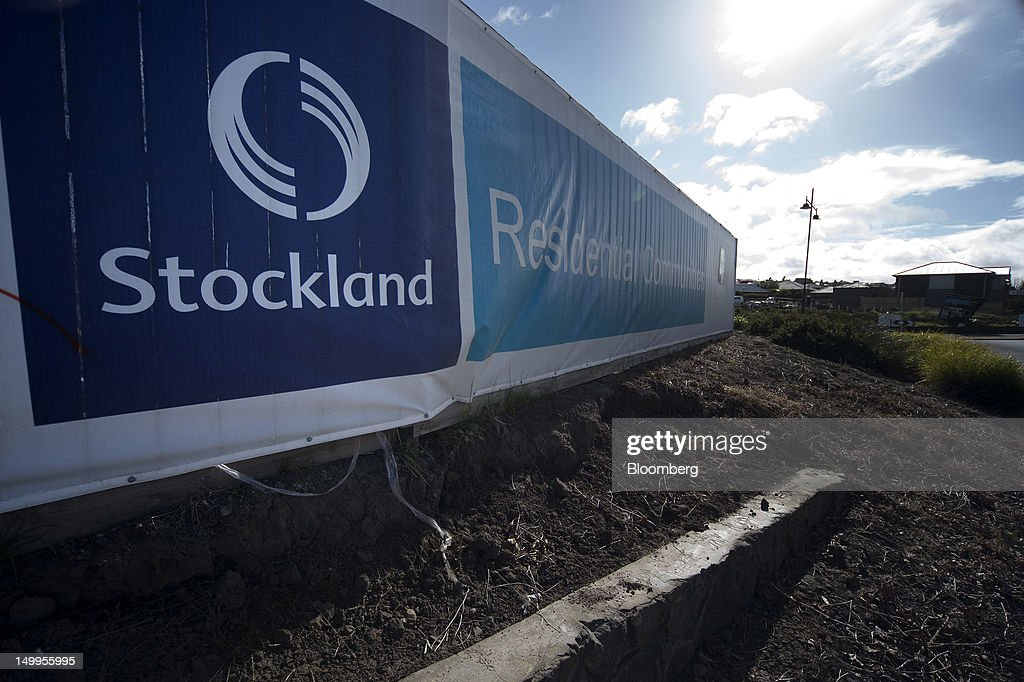 A Stockland banner covers construction fencing in the Stockland Highlands residential development in Craigieburn, an outer northern suburb of Melbourne, Australia, on Monday, Aug 6, 2012. Stockland, Australia's biggest diversified property trust, is expected to announce full-year results on Aug. 8. Photographer: Carla Gottgens/Bloomberg via Getty Images