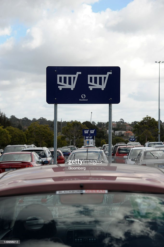 A Stockland shopping cart sign shows shoppers where to leave their carts in the carpark of Stockland's The Pines shopping centre in Doncaster East, an outer suburb of Melbourne, Australia, on Monday, Aug 6, 2012. Stockland, Australia's biggest diversified property trust, is expected to announce full-year results on Aug. 8. Photographer: Carla Gottgens/Bloomberg via Getty Images