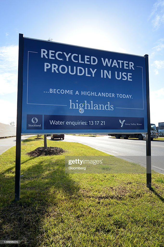 A Stockland sign shows visitors and residents that the Stockland Highlands residential development uses recycled water, in Craigieburn, an outer northern suburb of Melbourne, Australia, on Monday, Aug 6, 2012. Stockland, Australia's biggest diversified property trust, is expected to announce full-year results on Aug. 8. Photographer: Carla Gottgens/Bloomberg via Getty Images