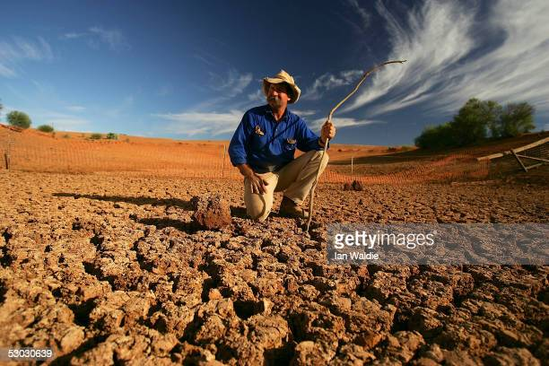 Stockman Gordon Litchfield from Wilpoorinna sheep and cattle station surveys the bottom of a dry dam on his property on June 7 2005 in Leigh Creek...