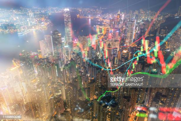 stockmarket and investment theme background with hong kong financial district central area - bear market stock pictures, royalty-free photos & images