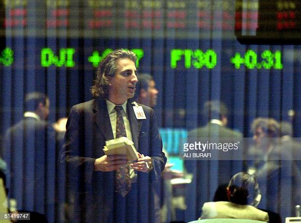 A stockmarket operator in Buenos Aires Argentina during trading 11 February 2002 The Argentine peso fell 11 February on its first day of free trade...