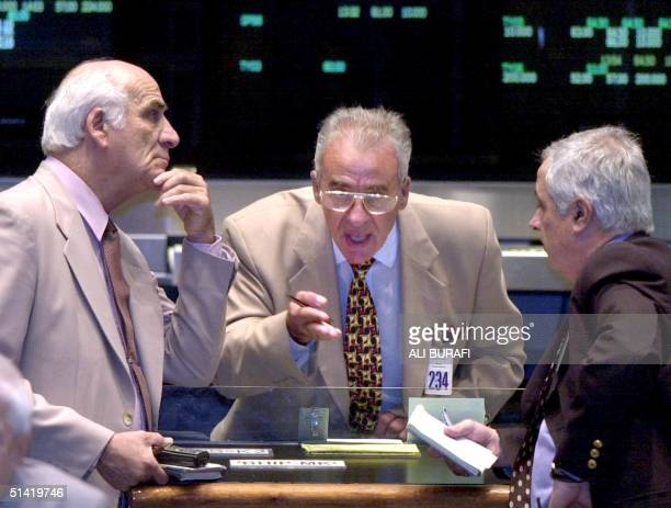 Stockmarket operators in Buenos Aires Argentina during trading 11 February 2002 The Argentine peso fell 11 February on its first day of free trade...