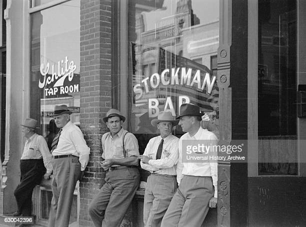 Stockmen in Front of Bar Main Street Miles City Montana USA Arthur Rothstein for Farm Security Administration June 1939