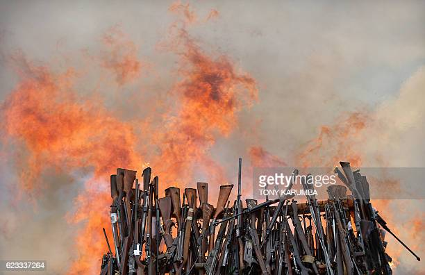 A stockpile of illegal arms confiscated from a variety of criminals goes up in smoke in Ngong in Kajiado county on November 15 2016 as a...