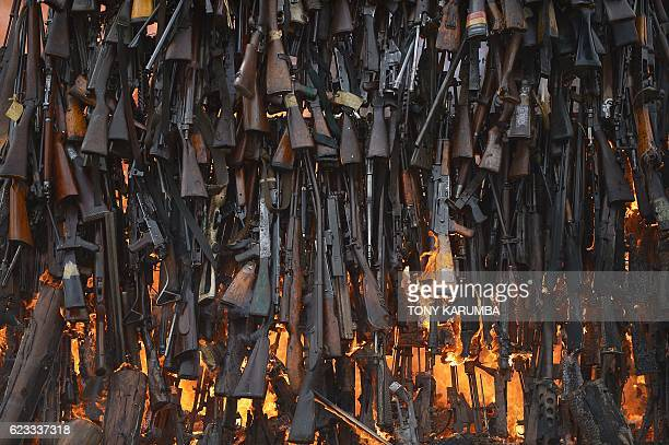 Stockpile of illegal arms confiscated from a variety of criminals goes up in smoke in Ngong in Kajiado county on November 15, 2016 as a demonstration...
