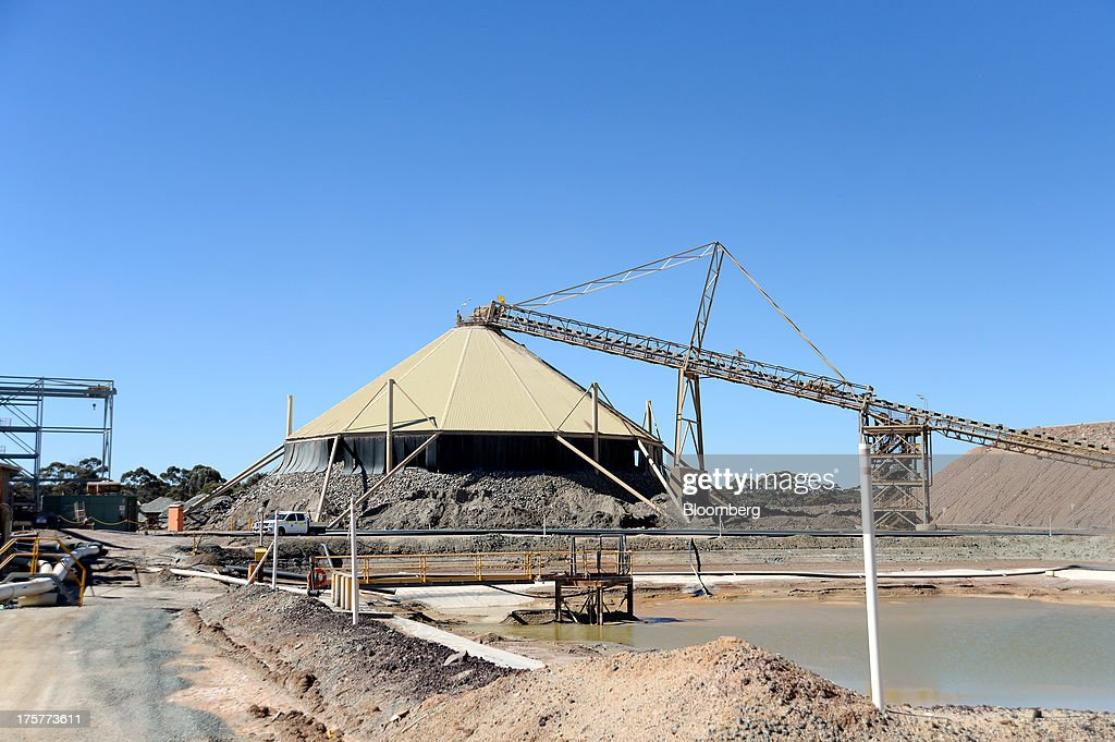 Stockpiles of ore sit under a shelter at the Norton Gold Fields Ltd. Paddington operations 35 kilometers north-west of Kalgoorlie, Australia, on Wednesday, Aug. 7, 2013. Norton, the Australian producer controlled by China's Zijin Mining Group Co., is seeking further acquisition targets as falling prices cut the value of mines. Photographer: Carla Gottgens/Bloomberg via Getty Images