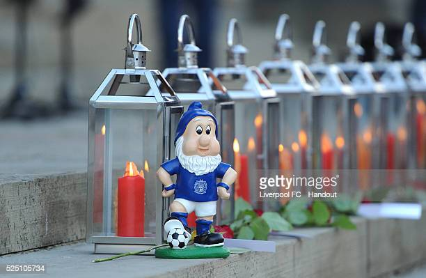 Stockport County gnome is placed by one of the 96 candles during the Hillsborough Vigil at St George's Hall on April 27, 2016 in Liverpool, England.