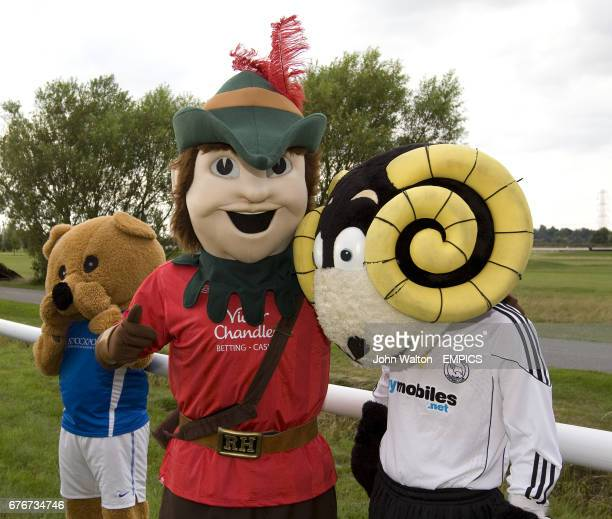 Stockport County's Animo watches while Nottingham Forest's Robin Hood and Derby County's Rammie pose for a photo