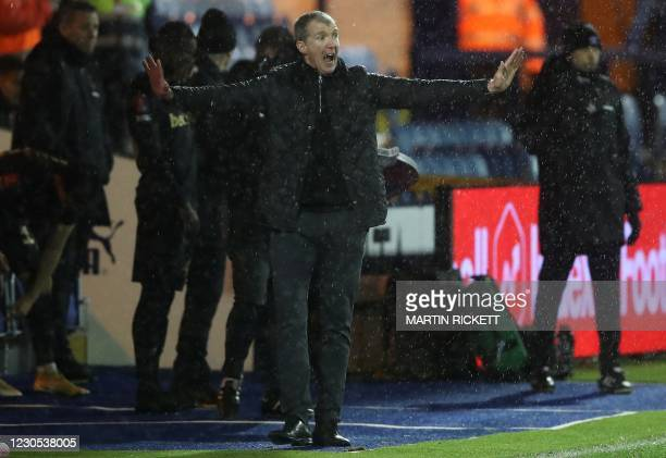 Stockport County's English manager Jim Gannon reacts during the English FA Cup third round football match between Stockport County and West Ham...