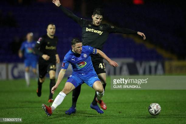 Stockport County's English midfielder John Rooney vies with West Ham United's English midfielder Declan Rice during the English FA Cup third round...