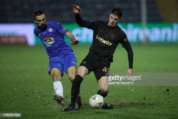 Stockport County's English midfielder Jordan Williams vies with West Ham United's English midfielder Declan Rice during the English FA Cup third...