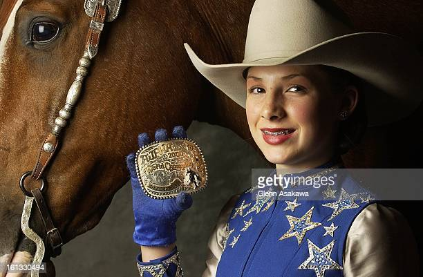 STOCKSHOW11503Sammie Jo Stone of Springville CA holds her 2000 World Champion show buckle she received in Fort Worth TX before taking part in a...