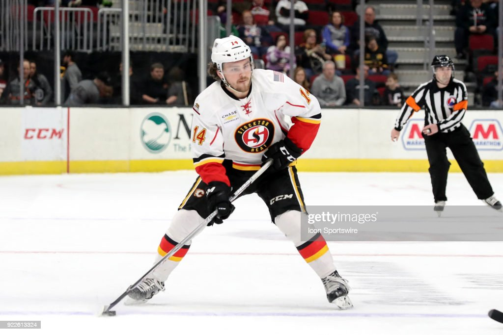 Stockton Heat defenceman Rasmus Andersson (14) looks to pass during the first period of the American Hockey League game between the Stockton Heat and Cleveland Monsters on February 21, 2018, at Quicken Loans Arena in Cleveland, OH. Stockton defeated Lake Erie 6-3.
