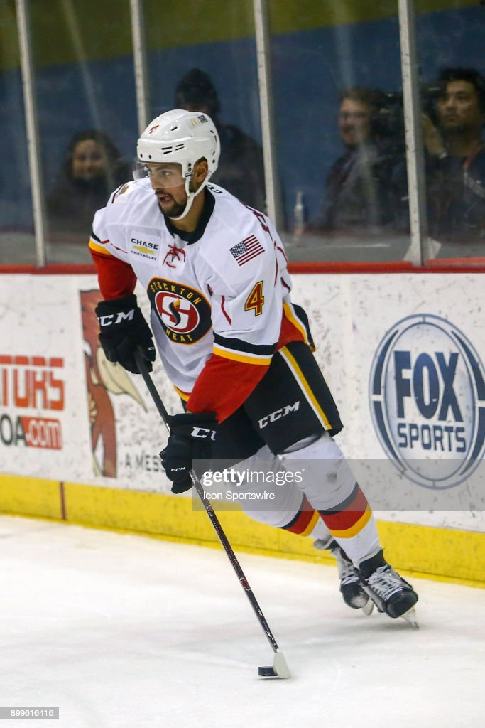 Stockton Heat defenseman Oliver Kylington (4) controls the puck during a hockey game between the Stockton Heat and Tucson Roadrunners on December 23, 2017, at Tucson Convention Center in Tucson, AZ. Stockton Heat defeats Tucson Roadrunners 2-1.