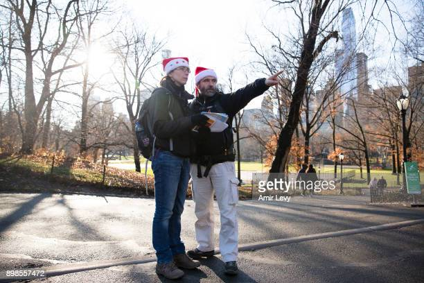 Stocq Jeanedouard and Kubica Virgine tourists from Belgium walk in Central Park on Christmas day on December 25 2017 in New York City Security in the...