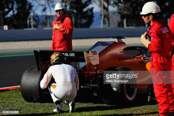 Stoffel Vandoorne of Belgium and McLaren F1 inspects his car after stopping on track during day one of F1 Winter Testing at Circuit de Catalunya on...