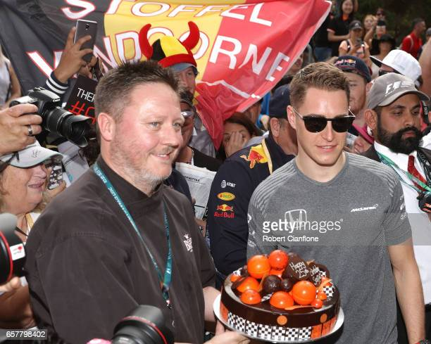 Stoffel Vandoorne of Belgium and McLaren Honda is greeted at the circuit with a birthday cake to celebrate his 24th birthday during the Australian...