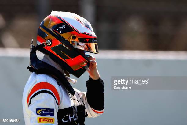 Stoffel Vandoorne of Belgium and McLaren Honda looks on after his car stopped on track during day three of Formula One winter testing at Circuit de...