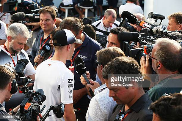 Stoffel Vandoorne of Belgium and McLaren Honda talks to the media after being announced as a McLaren driver for the 2017 season during qualifying for...