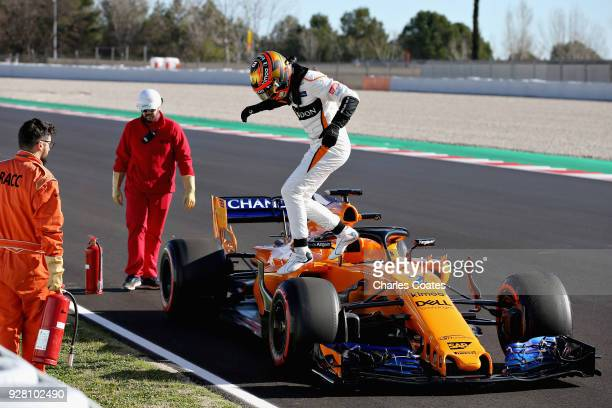 Stoffel Vandoorne of Belgium driving the McLaren F1 Team MCL33 Renault climbs from his car after stopping on track during day one of F1 Winter...
