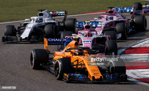 Stoffel Vandoorne of Belgium driving the McLaren F1 Team MCL33 Renault leads Lance Stroll of Canada driving the Williams Martini Racing FW41 Mercedes...