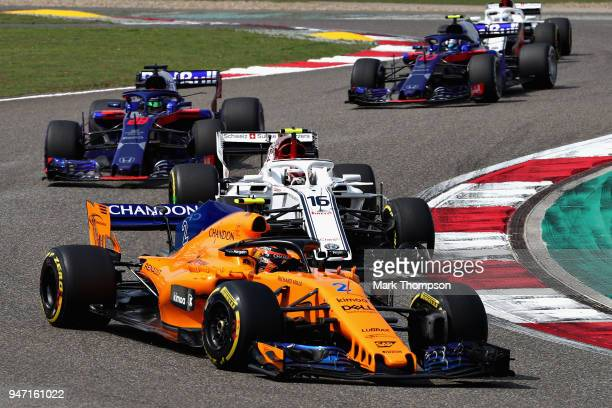 Stoffel Vandoorne of Belgium driving the McLaren F1 Team MCL33 Renault leads Charles Leclerc of Monaco driving the Alfa Romeo Sauber F1 Team C37...