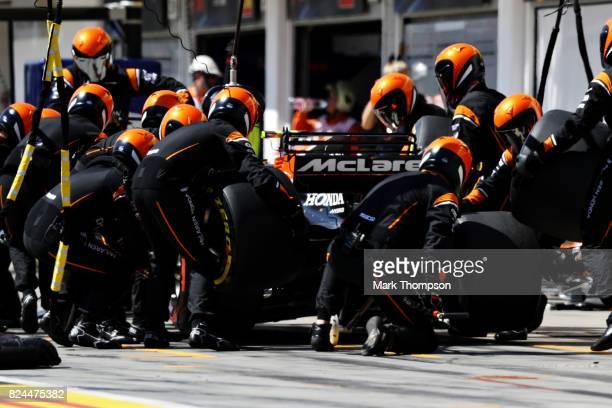 Stoffel Vandoorne of Belgium driving the McLaren Honda Formula 1 Team McLaren MCL32 makes a pit stop for new tyres during the Formula One Grand Prix...