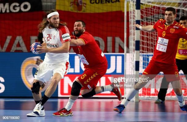 Stojanche Stoiliv of Macedonia challenges MikkelHansen of Denmark during the Men's Handball European Championship main round match between Macedonia...