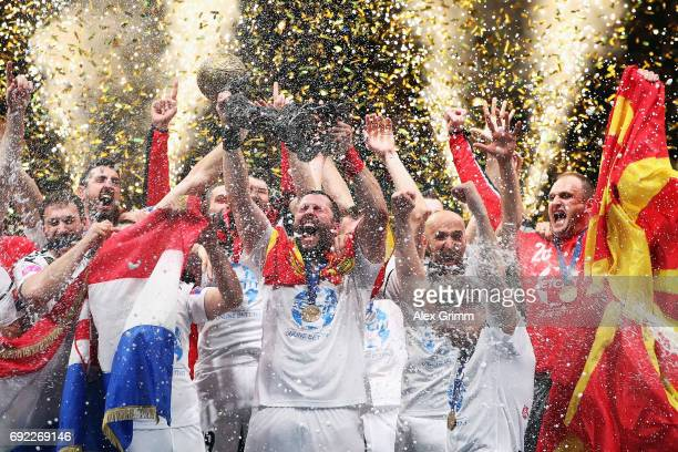Stojanche Stoilov and team mates of Vardar celebrate with the trophy after winning the VELUX EHF FINAL4 final between Paris SaintGermain Handball and...