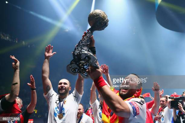 Stojanche Stoilov and team mates of Vardar present the trophy to the fans after winning the VELUX EHF FINAL4 final between Paris SaintGermain...