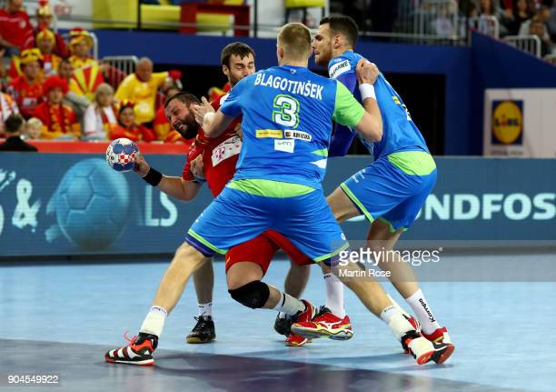 Stojanche Stoilov of Macedonia challenges Blaz Blagotinsek of Slovenia during the Men's Handball European Championship Group C match between...