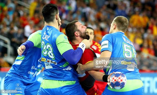 Stojanche Stoilov of Macedonia challenges Igor Zabic and Ziga Mlakar of Slovenia during the Men's Handball European Championship Group C match...