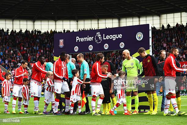 Stoke City and Manchester City players shake hands during the Premier League match between Stoke City and Manchester City at Bet365 Stadium on August...