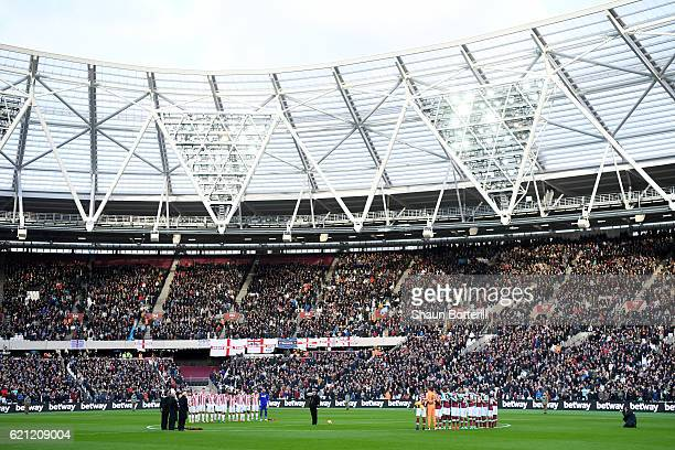 Stoke City and West Ham United teams take part in a minutes silence in honour of Remembrance Day during the Premier League match between West Ham...