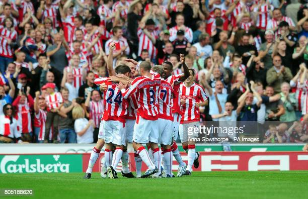 Stoke City celebrate an own goal by Burnley's Stephen Jordan during the Barclays Premier League match at the Britannia Stadium Stoke