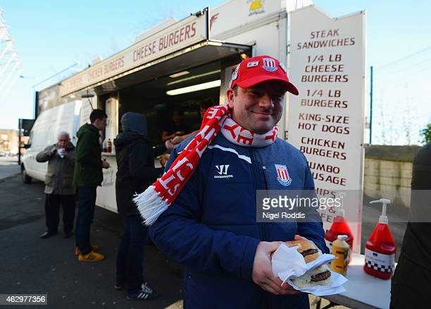 Stoke City fan enjoys prematch refreshments prior to the Barclays Premier League match between Newcastle United and Stoke City at St James' Park on...