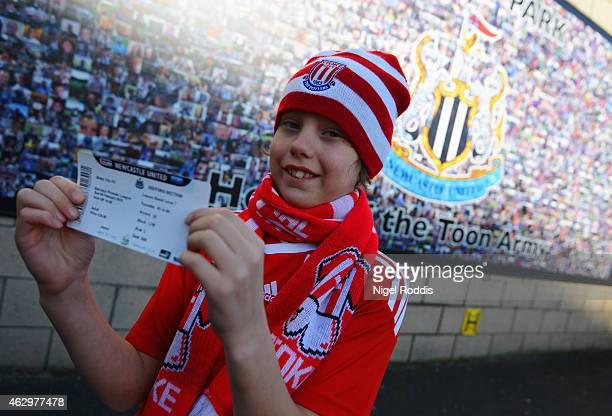 Stoke City fan shows a match a ticket prior to the Barclays Premier League match between Newcastle United and Stoke City at St James' Park on...