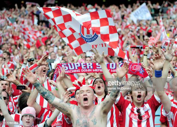 Stoke City fans celebrate their team winning at the final whistle during the FA Cup sponsored by EON semi final match between Bolton Wanderers and...